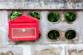 A red mailbox on home page. — Stock Photo