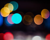 City at night - blurred photo and bokeh background — Stock Photo