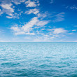 Blue clear sea with waves and sky — Stock Photo