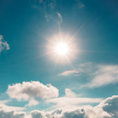 Blue sky with cloud and sun vintage background — Stock fotografie