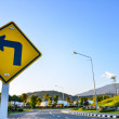 Turn left traffic sign on road — Stock Photo