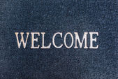 Old welcome doormat close up — Stock Photo