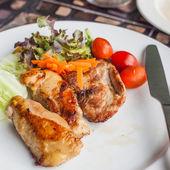 Steak and salad on white dish. — Stock Photo