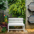 Stock Photo: White chair in the garden.