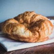 Stock Photo: Fresh croissants on wood gray background
