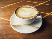 Cup of latte coffee on wooden — Stock Photo