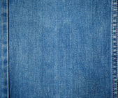 Old blue jeans background and texture close up — Zdjęcie stockowe