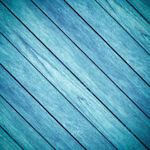 Old blue wooden background and crosswise — Stock Photo
