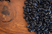 Close up bean black seed on wood table — Stock Photo