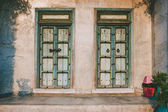 Traditional old door on home wall, vintage style — Stock fotografie