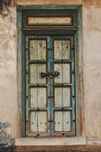 Traditional old door on home wall, vintage style — Stock Photo
