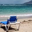 Beautiful sunny beach with deckchair — Stock Photo #33827473