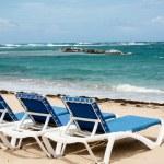 Calm beach with deckchairs under the blue sky — Stock Photo #33827485