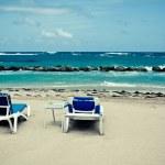 Calm beach with deckchairs under the blue sky — Stock Photo #33827523