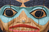 Detailed face of totem pole — Стоковое фото