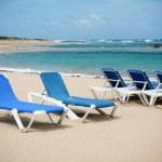 Calm beach with deckchairs under the blue sky — Stock Photo #33935079
