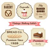 Set of vintage retro bakery labels, stamps and design elements, isolated vector illustrations — Stock Vector