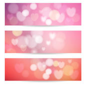 Set of abstract banners with lights, hearts and bokeh effect, vector illustration backgrounds — Stock Vector