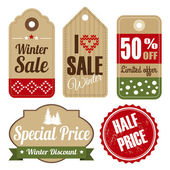 Retro set of winter christmas vintage sale and quality labels, cardboard tags, vector illustration — Stock Vector