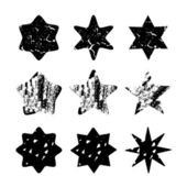 Set of black hand drawn isolated stars,vector objects — Vecteur