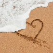 Shape of the heart in the sand on the beach — Стоковая фотография