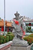 Estátua de um chinês, um instrumento musical — Fotografia Stock
