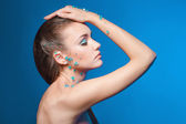 Beautiful naked young woman covered with blue crystals — Stock Photo