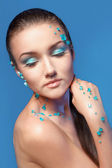 Beautiful naked young woman covered with blue crystals — Stok fotoğraf
