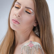 Beautiful young naked woman with bright makeup wearing necklace — Stock Photo