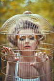 Beautiful blonde girl in a golden cage — Foto Stock