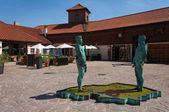 Pee statues in the courtyard of Franz Kafka Museum. Prague, Czec — Stock Photo