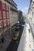 Narrow street in an old European city, Lisbon — Foto de Stock