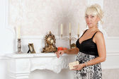 Pretty blonde woman in a luxury interior — Стоковое фото