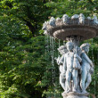 Fountain with statues of children in Paris, France — Stock Photo