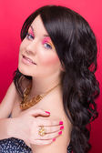 Beautiful girl with bright makeup and long curly hair — ストック写真