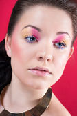 Close portrait of beautiful girl with bright makeup — Stock Photo