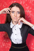 Fashionable business woman on red grunge background — 图库照片