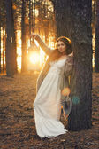 Young beautiful woman in the forest with magic lantern — Stock Photo