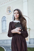 Young woman holding a bible — Stock Photo