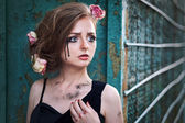 Fashionable portrait of a tearful girl with dry flowers. Retro s — Stock Photo