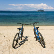 Stock Photo: Two bikes on the beach