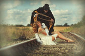 1920 style image of damsel in distress tied up by villain — Stock Photo