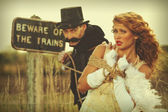 Donzela em apuros mulher amarrada por bandido — Fotografia Stock