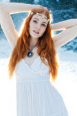 Snow Maiden. Whimsical image of beautiful red head woman standing in snow — Stock Photo