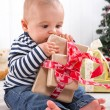 Baby unwrapping a present — Stock Photo