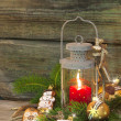 Rustic christmas lantern with candlelights — Stockfoto #33585525