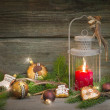 Rustic christmas lantern with candlelights — Stockfoto #33585565
