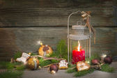 Rustic christmas lantern with candlelights — Stock Photo