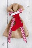 Present bag with Santa boot — Stock Photo