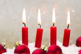Red candle with christmas ball advent — Stock Photo